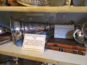 Silver speaking trumpet on display in the Ker Place Museum.